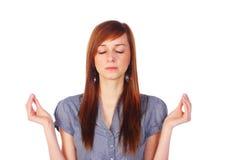 Adolescente meditating, aislado en blanco Imagenes de archivo