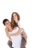 Adolescente montó en la parte posterior del novio Imagen de archivo libre de regalías