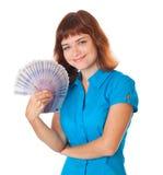 Adolescente-muchacha pelirroja con el dinero a disposición Foto de archivo
