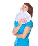 Adolescente-muchacha pelirroja con el dinero a disposición Fotos de archivo