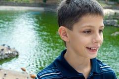 Adolescente na lagoa Fotos de Stock Royalty Free