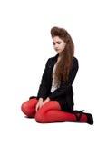 Adolescente na roupa preta e vermelha Fotografia de Stock