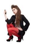 Adolescente na roupa preta e vermelha Imagem de Stock Royalty Free
