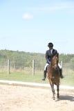 Adolescente negro a caballo Imagen de archivo libre de regalías