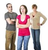 Adolescente nella difficoltà con i genitori immagini stock libere da diritti