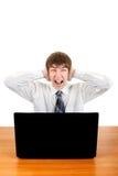 Adolescente nervioso con el ordenador portátil Fotos de archivo libres de regalías