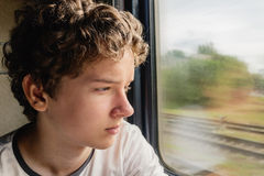 Adolescente no trem Fotografia de Stock Royalty Free