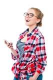 Adolescente o mujer joven en vidrios con la risa del teléfono celular Fotos de archivo libres de regalías