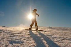 Adolescente o snowboard Imagenes de archivo