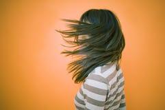 Adolescente obscurecido soplando el pelo Imágenes de archivo libres de regalías