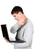 Adolescente ocupado con el ordenador portátil Fotos de archivo libres de regalías