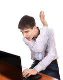 Adolescente ocupado con el ordenador portátil Imagen de archivo libre de regalías