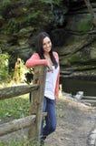 Adolescente pela cerca no outono Fotos de Stock