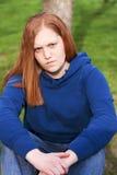 Adolescente pelirrojo infeliz Fotografía de archivo libre de regalías