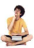 Adolescente pensativo con los libros. Imágenes de archivo libres de regalías