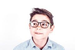 Adolescente pensativo con los vidrios Imagen de archivo libre de regalías