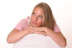 Adolescente pensativo en color de rosa Imagen de archivo libre de regalías