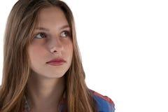 Adolescente pensativo que mira lejos Fotografía de archivo libre de regalías