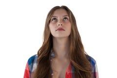 Adolescente pensativo que mira para arriba Imagen de archivo