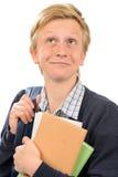 Adolescente pensativo que sostiene los libros Imagen de archivo