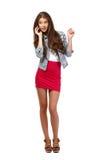 Adolescente piacevole che fa una chiamata Fotografie Stock