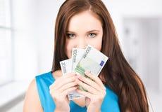 Adolescente precioso con el dinero Imagenes de archivo