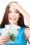 Adolescente precioso con el dinero Imagen de archivo libre de regalías
