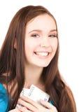 Adolescente precioso con el dinero Foto de archivo