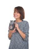Adolescente precioso con la cámara retra de la foto Imagenes de archivo