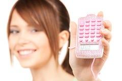 Adolescente precioso con la calculadora Fotos de archivo libres de regalías