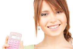 Adolescente precioso con la calculadora Fotografía de archivo libre de regalías
