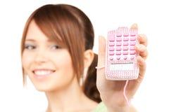 Adolescente precioso con la calculadora Imagen de archivo