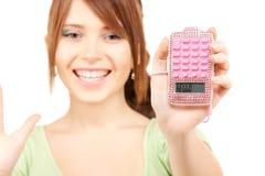 Adolescente precioso con la calculadora Foto de archivo libre de regalías