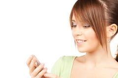 Adolescente precioso con la calculadora Imagen de archivo libre de regalías