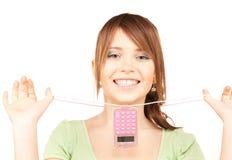 Adolescente precioso con la calculadora Foto de archivo