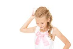 Adolescente precioso con la hucha Fotografía de archivo libre de regalías