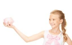 Adolescente precioso con la hucha Foto de archivo libre de regalías