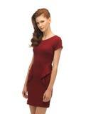 Adolescente precioso en vestido rojo Imágenes de archivo libres de regalías