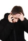 Adolescente preocupado con el teléfono móvil Imagen de archivo libre de regalías