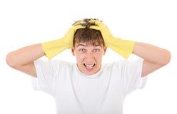 Adolescente preocupado en los guantes de goma Imagen de archivo libre de regalías