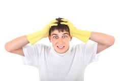 Adolescente preocupado en los guantes de goma Fotos de archivo libres de regalías