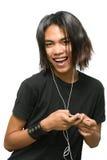 Adolescente punky que disfruta de música Imagen de archivo libre de regalías
