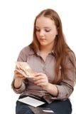 Adolescente que abre la tarjeta Imagenes de archivo