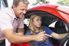 Adolescente que aprende cómo conducir Imagen de archivo libre de regalías