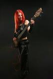 Adolescente que aprende tocar la guitarra Fotografía de archivo libre de regalías