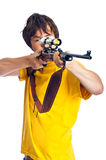 Adolescente que apunta un rifle Fotos de archivo