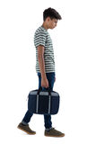 Adolescente que camina con el bolso Fotografía de archivo libre de regalías