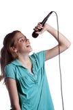 Adolescente que canta en blanco Foto de archivo libre de regalías