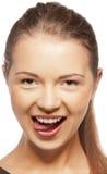 Adolescente que cola para fora sua língua Imagem de Stock