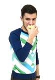 Adolescente que come la manzana Fotografía de archivo libre de regalías